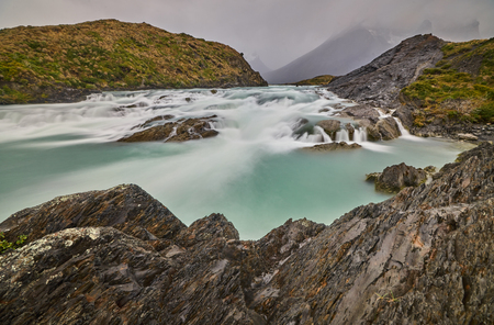 View of the Salto Grande waterfall in the Torres Del Paine park in cloudy weather. Chilean Patagonia in Autumn