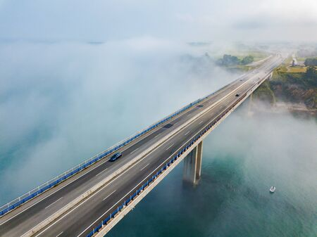 Aerial view on dos Santos bridge during fog and bay. Near Ribadeo in Northern Spain. Stock Photo