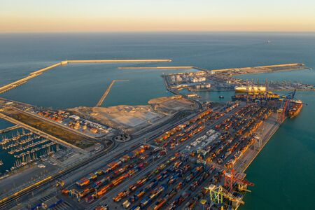 Aerial view of the container terminal of the seaport of the city of Valencia and the ship during loading