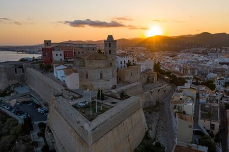 Aerial view of the old city on the island of Ibiza during sunset