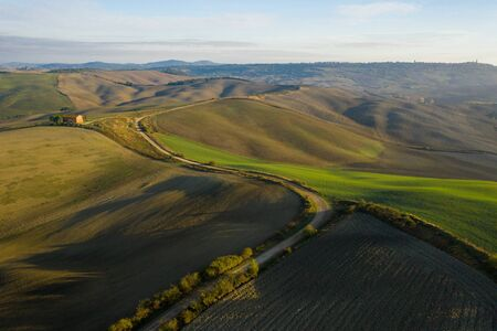 Aerial view of the fields, wineries near San Quirico dOrcia. Tuscany autumn sunrise