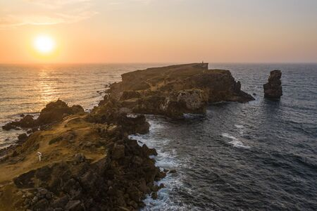 Aerial view of the coastline and cliffs during sunset near the city of Peniche. Portugal in the summer