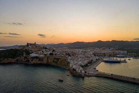 Aerial view of the old city on the island of Ibiza during sunset.