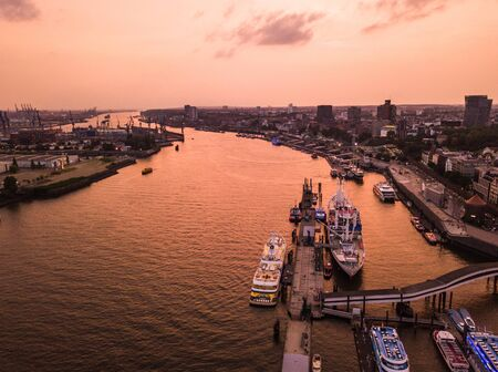 Aerial view of the Elbe River and ships in the city of Hamburg during sunset. Geramania in the summer.