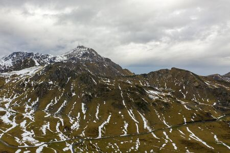 Aerial view of the valley and mountains after the first snow near the village of La Mongie. Pyrenees of France