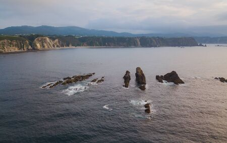 Aerial view of the coastline and cliffs during sunset on the beach of Quintana and Estaca. Northern Spain in summer.