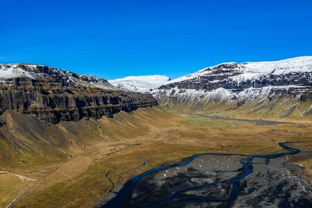 Aerial view of mountains and valley in Iceland. Imagens