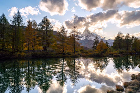 Beautiful autumn landscapes. Amazing sunset on Lake Grindjisee, Swiss Alps, Zermatt resort location, Switzerland, Europe. Incredible autumn view of the Matterhorn, reflected in the calm waters of the lake