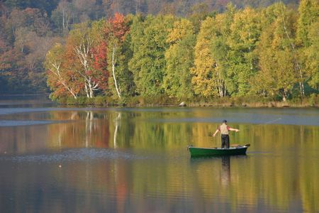 Fly fisherman on Vermont lake photo