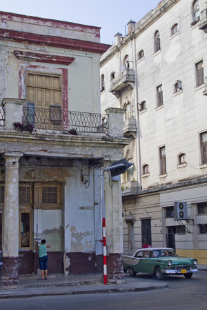 meant: Dilapidated buildings and an old classic cuban car  Past international embargoes have meant Cuba has maintained many pre-revolutions vehicles