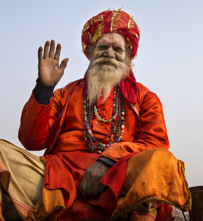 ghat: Holy Man sitting at the Ghats at Varanasi, the holiest of the seven sacred cities (Sapta Puri) in Hinduism, and Jainism