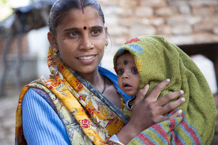 kohl: Indian mother and baby with traditional bindi and kohl around baby
