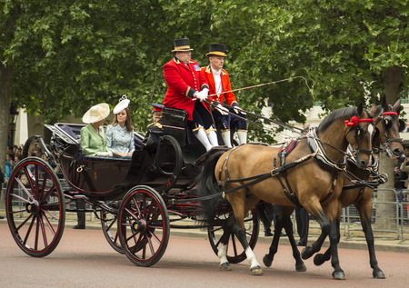 middleton: London England  June 13 2015: Kate Duchess of Cambridge in an open carriage with Camilla Duchess of Cornwall and Prince Harry for trooping the colour 2015 to mark the Queens official birthday London UK.