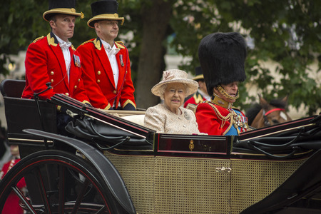 Queen Elizabeth II in an open carriage with Prince Philip. Trooping the colour 2015 marking the Queens official birthday London UK Editorial