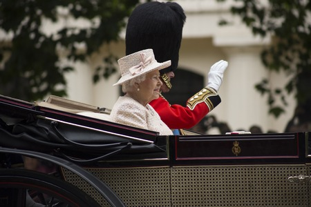 queen elizabeth ii: Queen Elizabeth II in an open carriage with Prince Philip. Trooping the colour 2015 marking the Queens official birthday, London, UK Editorial