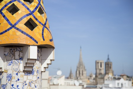 evident: Barcelona, Spain - September 25, 2015: Gaudi Chimney, Palau Guell, Gaudi broken tile mosacis and strange decorated chimneys are evident in his early work at Palau Guell. Editorial