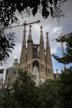 profound: Barcelona, Spain - September 19, 2015: Sagrada Familia Passion facade side. Gaudis profound catholicism inspired his designs of Sagrada Familia.