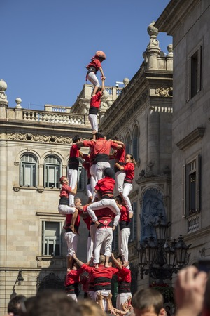 merce: Barcelona, Spain - September 20, 2015: Castelers at La Merce. Human Castle building is a Catalonian tradition and has been  declared by UNESCO to be a Masterpiece of the Oral and Intangible Heritage of Humanity Editorial