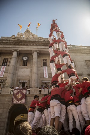 merce: Barcelona, Spain - September 20, 2015: Castelers at La Merce. Human Castle building is a Catalonian tradition and is a UNESCO Masterpiece of the Oral and Intangible Heritage of Humanity