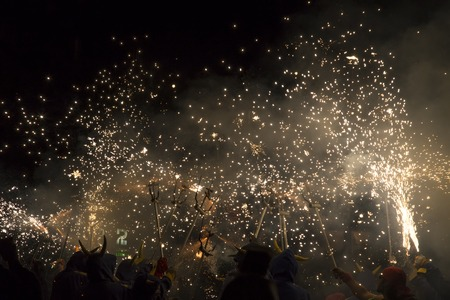 merce: Barcelona, Spain- September 20, 2015: Fire Run or Correfoc, La Merce, Groups dress as devils and parade down the streets letting off fireworks.