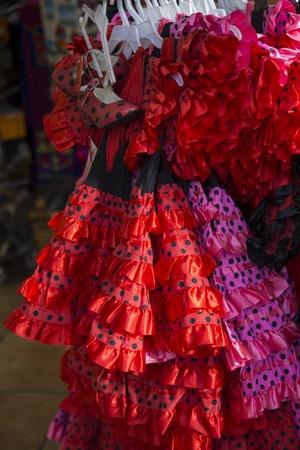 flamenco dress: Spanish flamenco dresses for sale on a stand, Barcelona Stock Photo