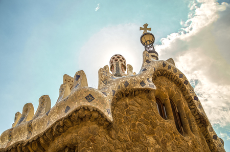 gatehouse: Barcelona, Spain - September 21, 2015: Trencalis covered Gatehouse, Park Guell.