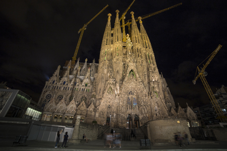 catholicism: Barcelona, Spain - September 19, 2015: Sagrada Familia at night. Gaudis profound catholicism inspired his designs of Sagrada Familia.