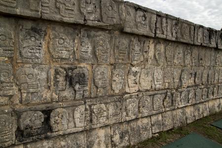 itza: Mayan wall of carved stone skulls, Chichen Itza, Mexico