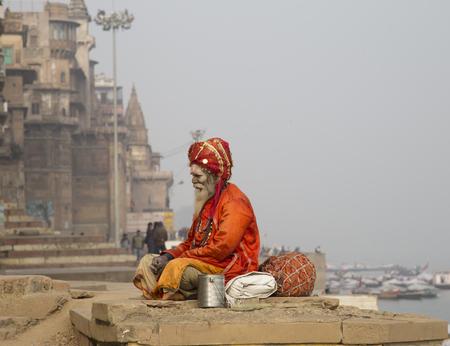 ghat: Varanasi, India - December 27, 2014: Holy Man Varanasi, the holiest of the seven sacred cities ,Sapta Puri, in Hinduism, and Jainism.