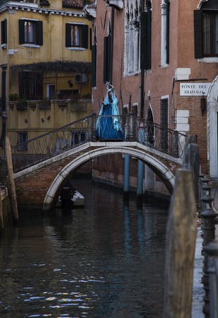 carnivale: Venice, Italy - February 6, 2016: Reveller in Venetian Carnivale Costume. Authorities have increased surveillance throughout the city however, authorities rejected a proposal to ban revellers from wearing masks. Editorial