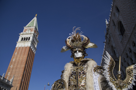 saint mark's square: Venice, Italy - February 6, 2016: Reveller in Venetian Carnivale Costume in Saint Marks Square. Authorities have increased surveillance throughout the city however, authorities rejected a proposal to ban revellers from wearing masks. Editorial