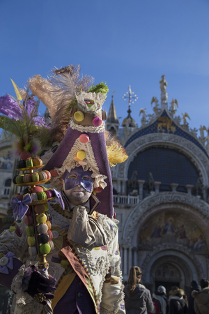 saint marks square: Venice, Italy - February 6, 2016: Reveller in Venetian Carnivale Costume in Saint Marks Square. Authorities have increased surveillance throughout the city however, authorities rejected a proposal to ban revellers from wearing masks. Editorial