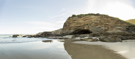 nsw: Headland of with main cave of Caves Beach, NSW, Australia