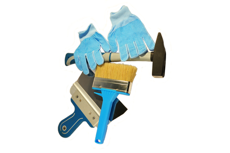 carrying out: The tools for repairs hammer, brush, trowel and gloves. Necessary for carrying out construction and finishing works Stock Photo