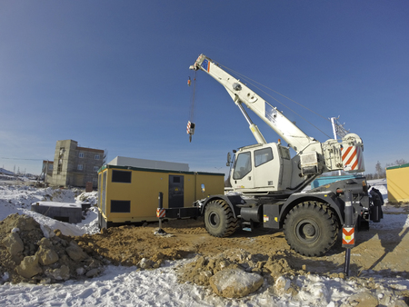Mobile crane in work at a construction site Stock Photo