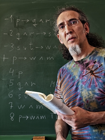 philosophy of logic: Middle aged teacher with book and blackboard