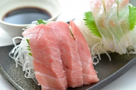Sliced raw fish called Sashimi Stock Photo