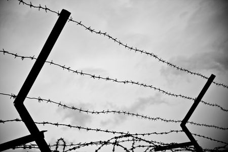 photo of old rusty barbed wire against sky Stock Photo - 5124639