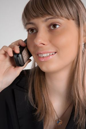 close up photo of the beautiful happy businesswoman talking on the phone Stock Photo - 7289846