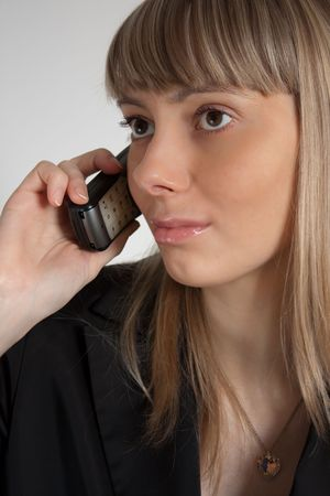 close up photo of the beautiful happy businesswoman talking on the phone Stock Photo - 7289848