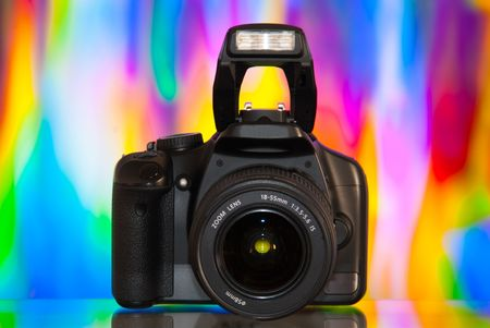 Dslr camera isolated on colorful background with reflection Stock Photo - 5163339