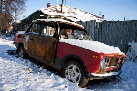 rust covered: photo of old rusty car covered with snow Stock Photo
