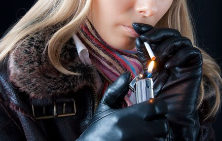 gas lighter: beautiful young girl with lighter smoking cigarette