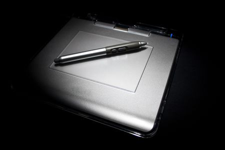 stylus: white tablet with stylus fading into black background