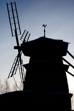 photo of the windmill silhouette with blue sky in background stock