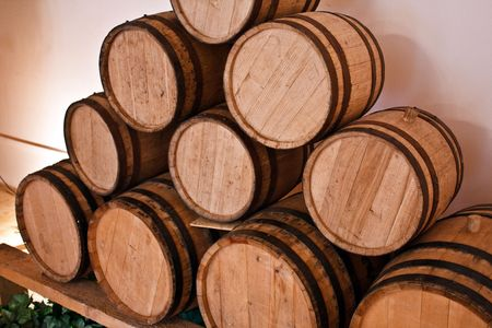 angle bar: wooden wine barrels in the wineyard cellar Stock Photo