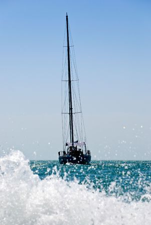drifting: yacht drifting in the sea with sails down.  Stock Photo