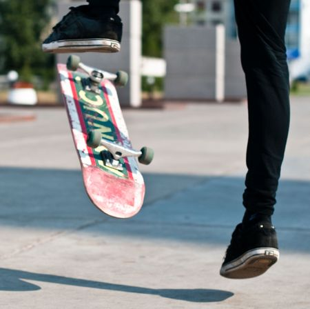 skater: young skater perfoming stunt on his board
