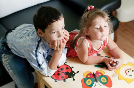 a little boy and girl, brother and sister, are watching a tv Stock Photo - 5599241
