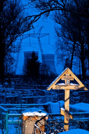 graveyard with nuclear power plant in background photo